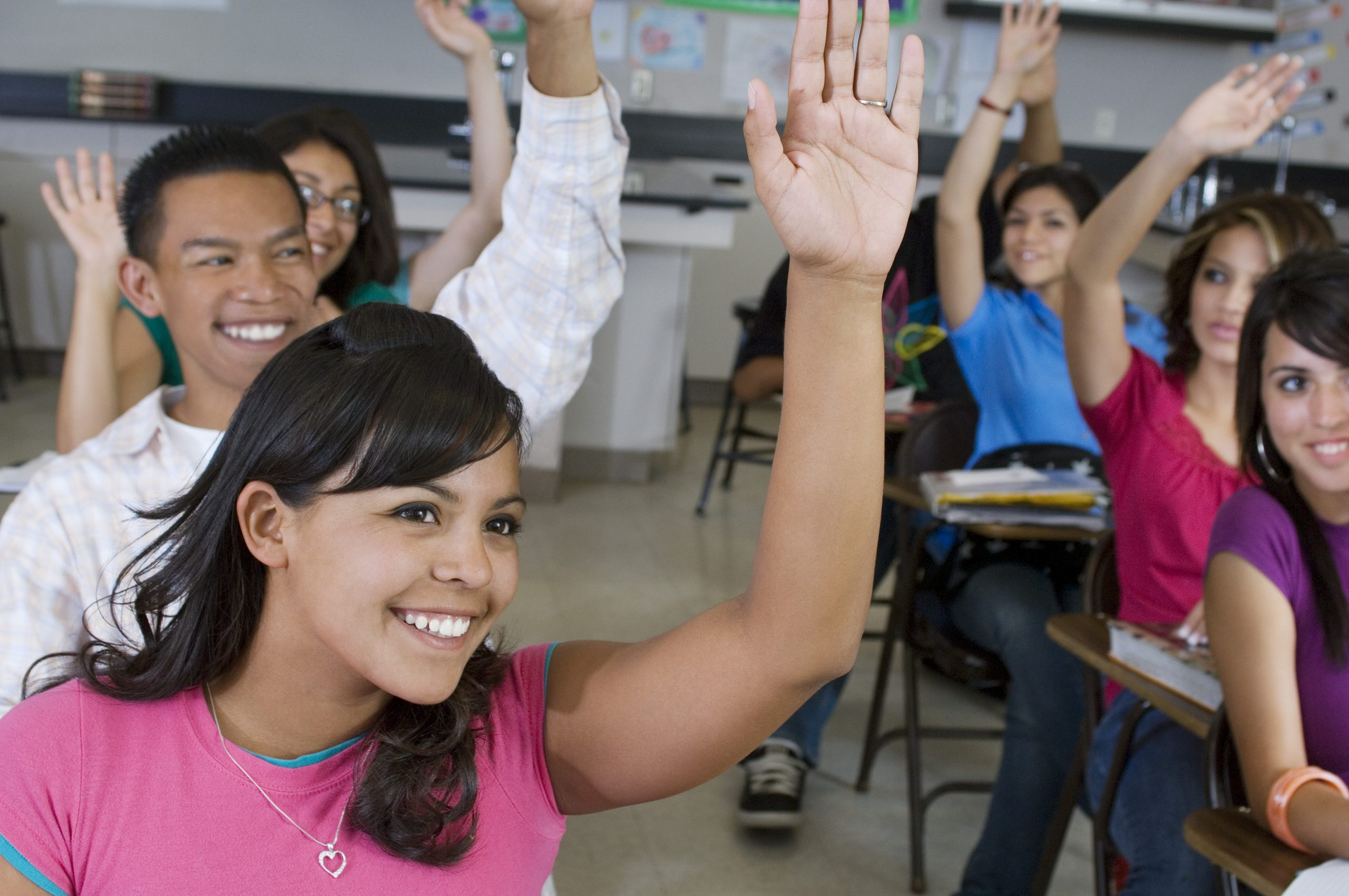High School Students Raising Their Hands in Class themba tutors