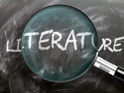Learn, study and inspect literature - pictured as a magnifying glass enlarging word literature, symbolizes researching, exploring and analyzing meaning of literature, 3d illustration